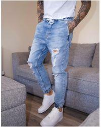 Bershka Denim sweatpants With Rips - Blue