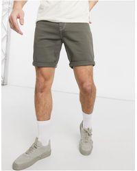 ASOS Pantaloncini di jeans skinny lavaggio kaki - Verde