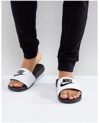 Nike Черные Шлепанцы С Белым Ремешком Benassi Jdi-белый