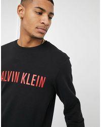 Calvin Klein – Sweatshirt mit Logo - Schwarz