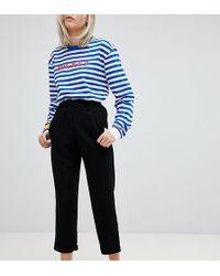 94ed72f53 Pantalones tapered de - Negro