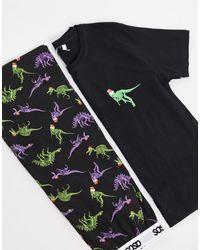 ASOS – Lounge – Weihnachtliches Pyjamaset aus T-Shirt und Hose mit Dinosaurier-Print - Schwarz