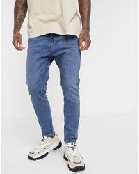 Pull&Bear – Join Life – Schmal zulaufende Karotten-Jeans - Blau