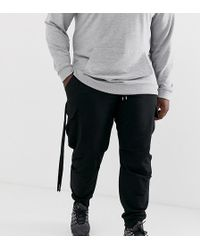 ASOS Plus Tapered Joggers With Cargo Pockets And Strapping - Black
