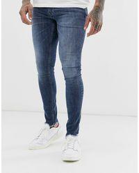 Jack & Jones Intelligence - Spray-on Jeans Met Onafgewerkte Zoom En Mid Wash - Blauw