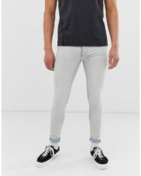 Cheap Monday Him Spray Super Skinny Jeans In Bleach Blue