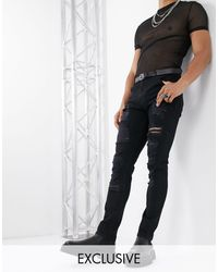 Reclaimed (vintage) Skinny Fit Jeans With Rips - Black