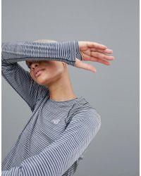 New Balance - Running Long Sleeve Stripe Top - Lyst