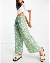 Mango Pantaloni con stampa a fiori, colore verde