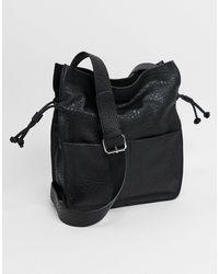 ASOS Bolso tote suave con cordón ajustable en poliuretano negro granulado