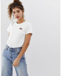 Levi S Levi S Orange Tab Stripe Logo T Shirt In White Lyst