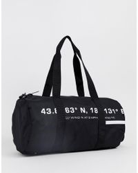 ASOS Barrel Bag In Black With White Text Print