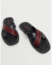 Emporio Armani Slider nere con fasce incrociate con logo - Nero