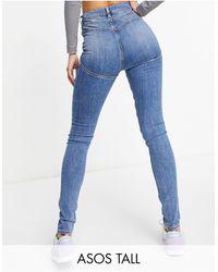 ASOS ASOS DESIGN Tall - Hourglass - Jeans skinny a vita alta modellanti e push-up lavaggio medio - Blu