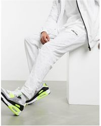 Ellesse X Smiley Repubblica All-over Print Trackpants - White