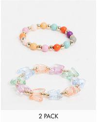 ASOS – Perlenarmbänder mit pastellfarbenen Schmetterlinganhängern im Doppelpack - Weiß