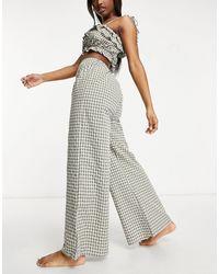 Fashion Union Esclusiva - Pantaloni da mare kaki a quadri a vita alta con fondo ampio - Verde