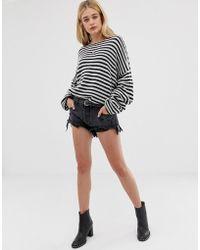 One Teaspoon Pantalones cortos de talle bajo y corte holgado con bajo desgastado Rollers - Negro