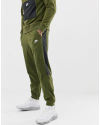 Nike Borg Joggers With Side Stripe In Green 929126-395