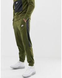 Nike Joggers de borreguito en verde con raya lateral 929126-395