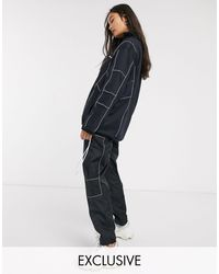 Ellesse Wide Leg Tracksuit joggers With Reflective Piping Co-ord - Black