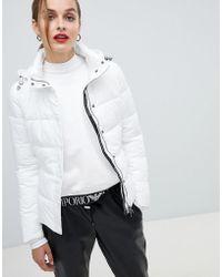 Emporio Armani Doudoune courte avec bande griffe - Blanc