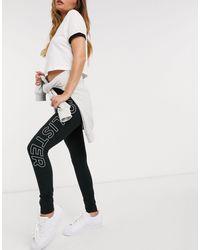 Hollister Legging avec logo sur le côté - Noir