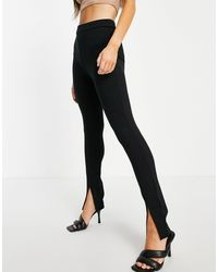 Mango Pantaloni slim con spacco sul davanti, colore nero