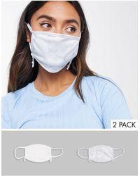 Skinnydip London Esclusiva - Confezione da 2 mascherine con laccetti regolabili bianco tinta unita e con stampa marmo