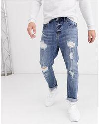 ASOS Jeans Met Smaltoelopende Pijpen - Blauw