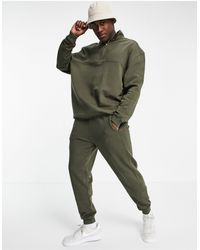 ASOS Tracksuit With Half Zip Sweatshirt And Skinny Track Pants-green