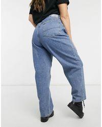 Collusion Plus - x014 - Jeans baggy dad fit anni '90 con vita asimmetrica lavaggio blu cowboy