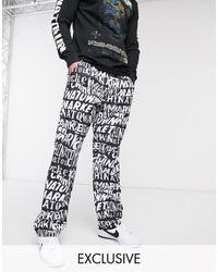 Chinatown Market Repeat Logo Lightweight Woven Pants - Black