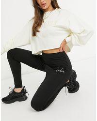 The Couture Club Legging taille haute avec imprimé contour du logo - Noir