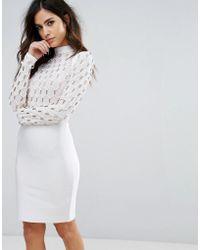 Wow Couture Robe en tissu effet bandage à encolure haute et détails dorés effet cage - Blanc