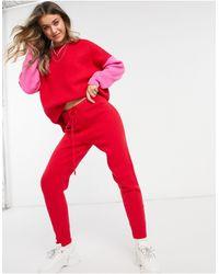 Never Fully Dressed Jogger d'ensemble en maille noué à la taille - Rouge