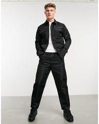 Native Youth Pantalones cargo negros en nylon brillante cyrus