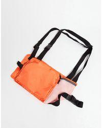 ASOS Bolso con diseño tipo arnés en naranja y detalles