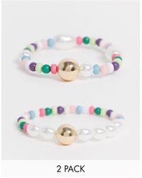 ASOS – Set mit zwei Perlenarmbändern mit einzelnen goldenen und perlmuttfarbenen Perlen - Mehrfarbig