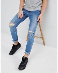 Dr. Denim Clark - Jeans slim effetto invecchiato grigio pietra chiaro con strappi sulle ginocchia - Blu