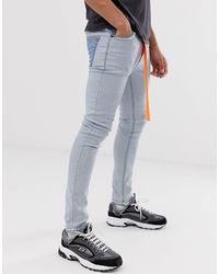 ASOS Jean super skinny avec effet envers - délavé moyen - Bleu