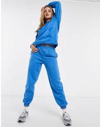 New Look Joggers extragrandes azul claro con bajos ajustados