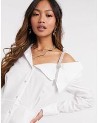 River Island Robe chemise courte asymétrique avec strass - Blanc