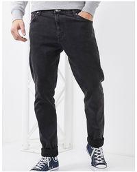 Weekday Sunday - Ruimvallende Comfortabele Jeans Met Smaltoelopende Pijpen - Zwart