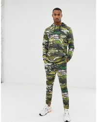 ASOS Trainingsanzug mit Kapuzenpullover und enger Jogginghose mit Berg-Print - Grün