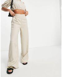 NA-KD X Jazmin Azizam - Pantaloni con fondo ampio beige - Multicolore