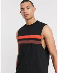 ASOS Camiseta holgada sin mangas con sisas caídas y paneles en contraste en negro