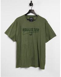 Hollister - Меланжевая Однотонная Футболка Оливкового Цвета Из Технологичного Материала С Логотипом -зеленый Цвет - Lyst
