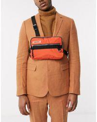 ASOS – Rave – Tasche mit Brustriemen - Orange