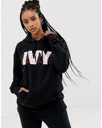 Ivy Park Sudadera con capucha y logo a capas en negro